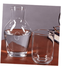 Set out a carafe of water and a glass on the nightstand