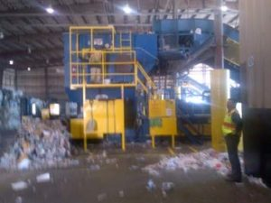 shredded documents being compressed and baled for shipping